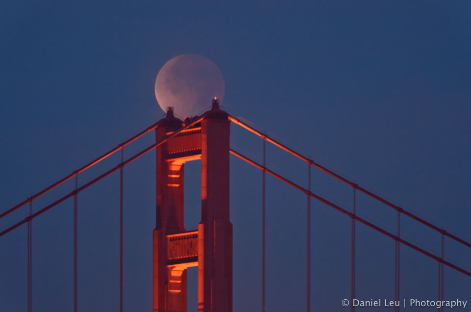 Looks like the moon takes a break and rests on top of the Golden Gate tower.